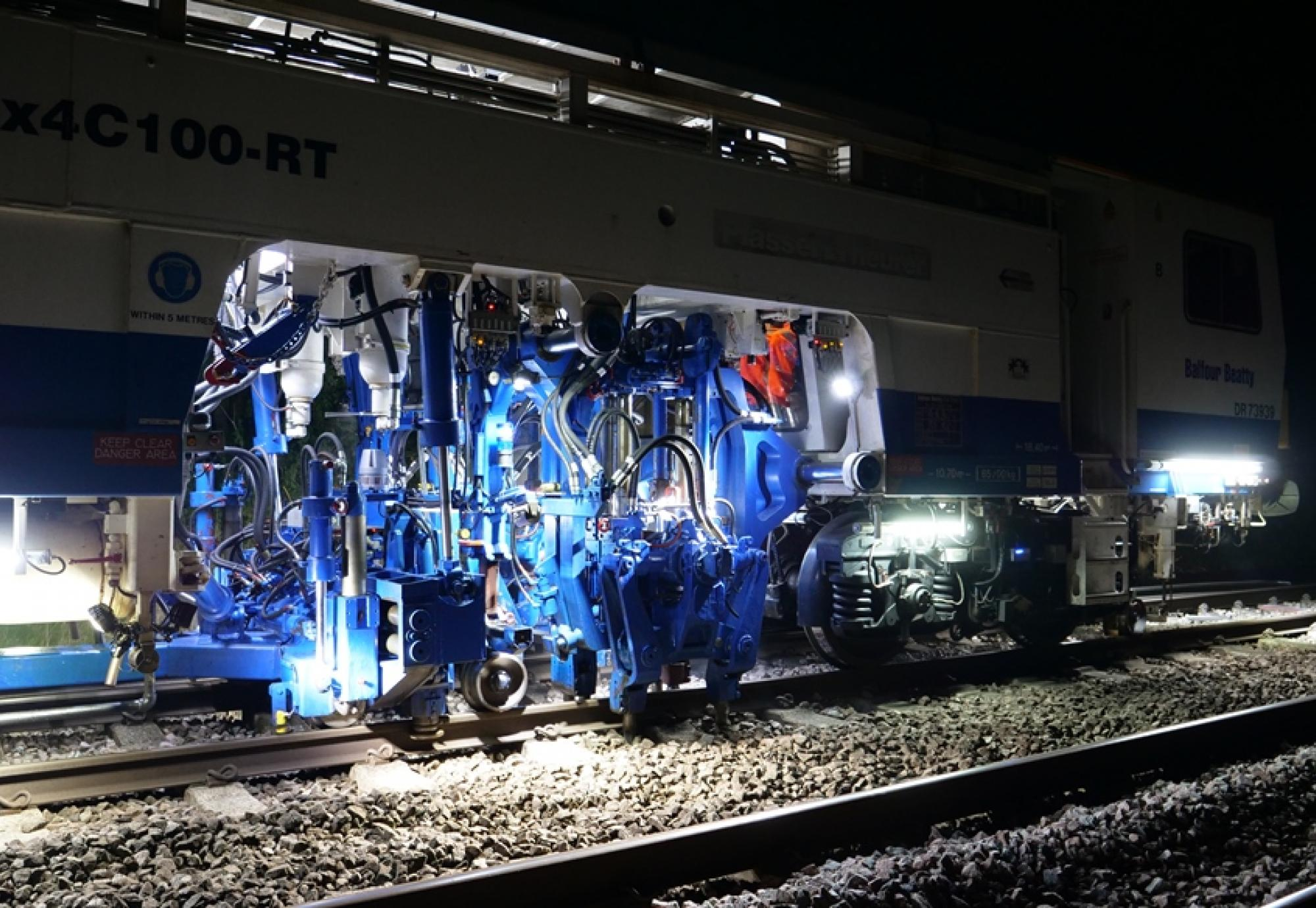 Network Rail's tamping machines in action in Kent