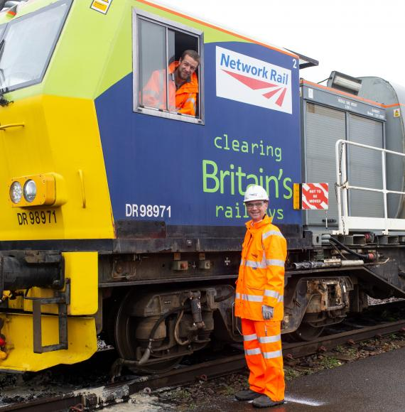 Paul Plawecki of Balfour Beatty and Rob Davis of Network Rail with a leaf-busting train