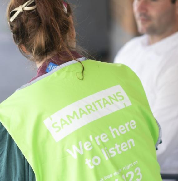 Samaritans volunteer speaking with a male