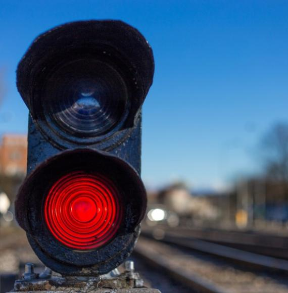 Railway red traffic light stop signal.