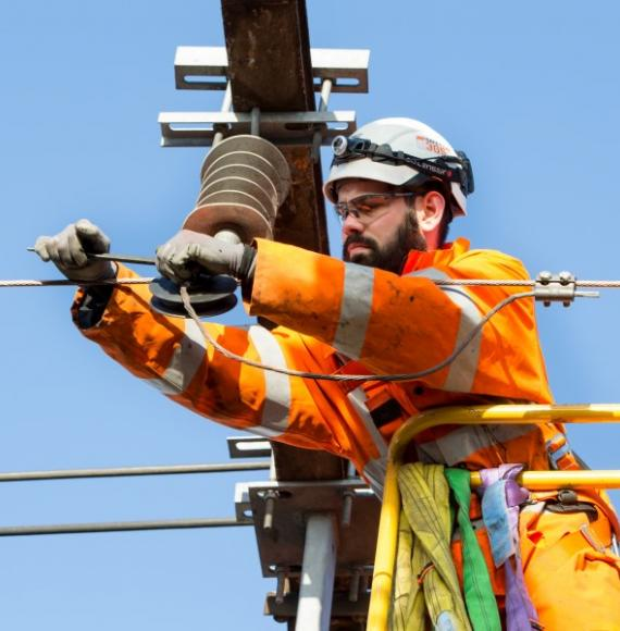 Man doing overhead line equipment work
