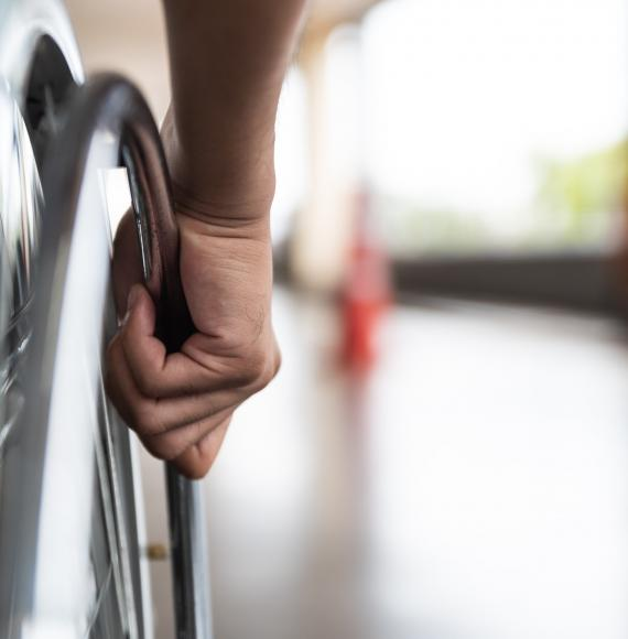 Wheelchair user on an out-of-focus platform
