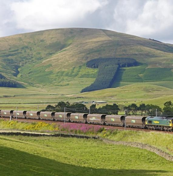 reightliner Heavy Haul coal train as it passes through scenic Scottish countryside.