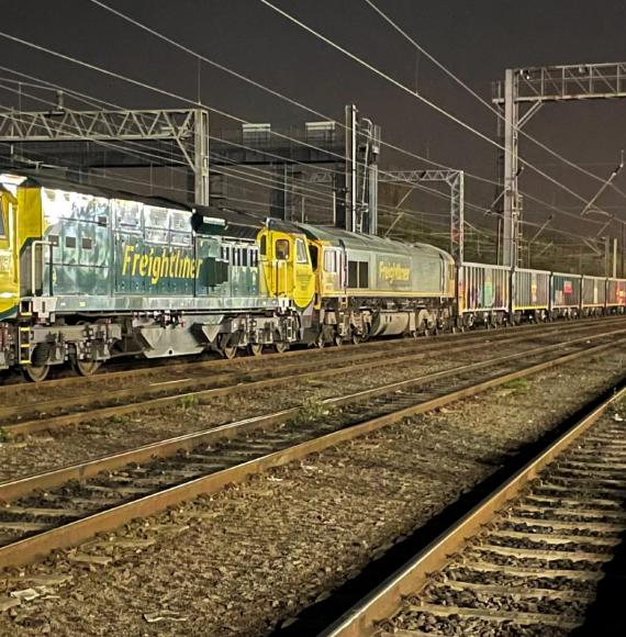 Jumbo freight train operating on the West Coast Main Line