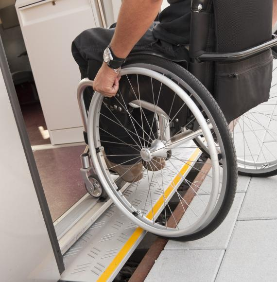 Wheelchair user boarding a train