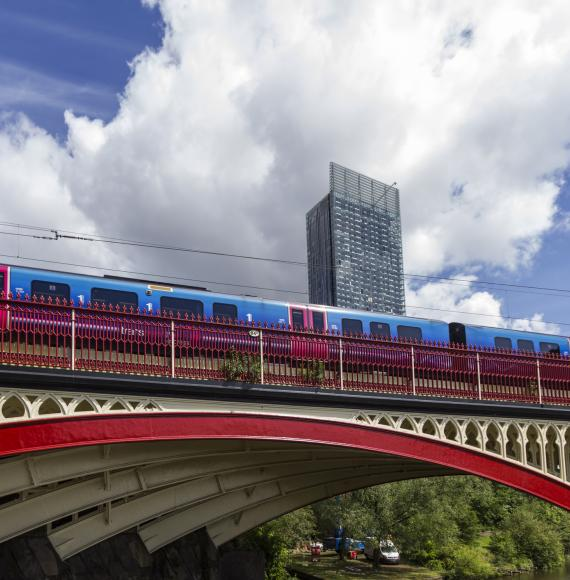 Train passing over a bridge in Manchester