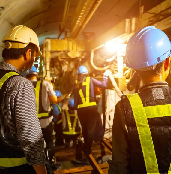 Engineers in a tunnel performing maintenance
