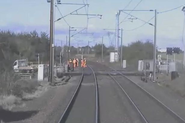 Staff scramble to safety from 125mph train in near-miss due to 'unsafe and unofficial' working practices