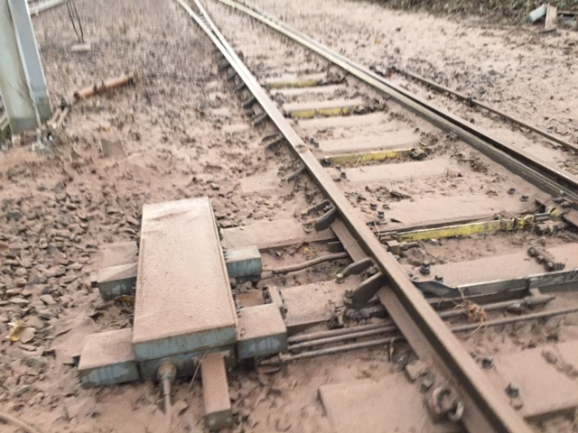 Mud covered and damaged track north of Carlisle
