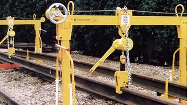 Rail workers narrowly avoid injury as iron-man breaks free