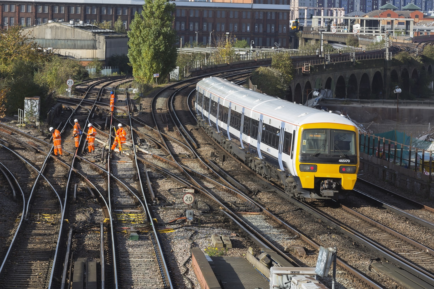Train's near miss with track workers caused by mix-up over location