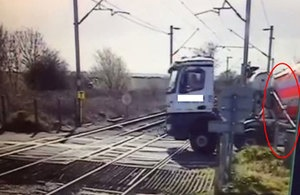 RAIB to investigate lorry's near miss with train at level crossing